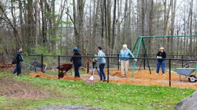 Photograph of members working on the new playground